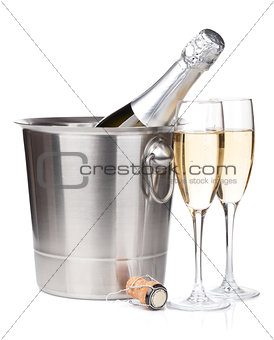 Champagne bottle in bucket and two glasses