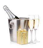 Champagne bottle in bucket, glasses and gift box