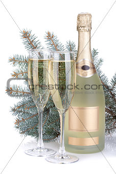 Champagne glasses, bottle and fir tree
