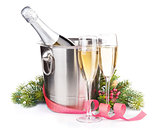 Christmas champagne bottle in bucket, glasses and fir tree