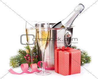 Christmas champagne bottle in bucket, glasses and gift box