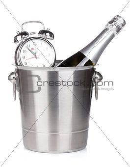 Champagne bottle in bucket and alarm clock