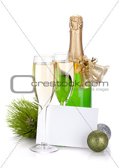 Champagne, empty card and christmas decor