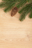 Christmas fir tree on wooden board