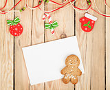 Christmas decor, gingerbread cookie and card for copy space