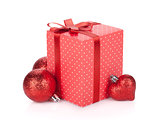 Gift box with ribbon and bow and christmas decor