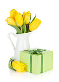 Yellow tulips in a jug and gift box