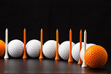 Golf balls on the black background