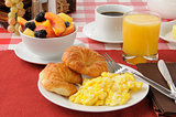 Scrambled eggs and croissants