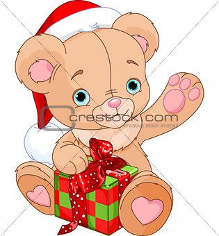 Christmas Teddy Bear holding gift
