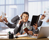 businessman with eight hands in elegant suit working hold notepa