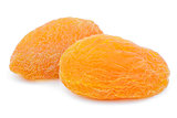 Two dried apricot fruits on white