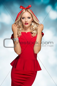 blonde girl with bow on head