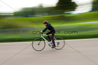 Boy riding a bike in a park