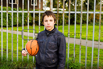 Portrait of serious boy street basket player