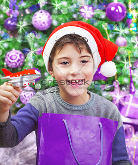 Boy enjoying Christmas gift