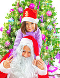 Little girl with Santa Claus