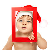 Child dressed in red Christmas hat