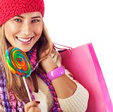 Girl lick sweets and holding pink bag