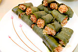 Sticky rice steamed in bamboo leaves