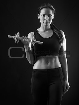 Beautiful woman doing dumbbell curl