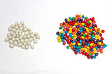 white and colorful candy scattered