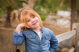 Cute Young Girl Posing for a Portrait Outside