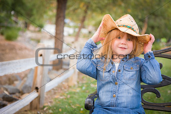 Cute Young Girl Wearing Cowboy Hat Posing for Portrait Outside
