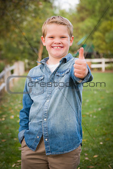 Handsome Young Boy Giving the Thumbs Up