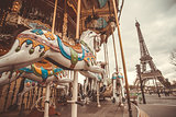 The retro carousel and the Eiffel Tower with a retro effect