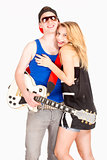 Teenage Couple - Girl Embracing her Boyfriend with Guitar