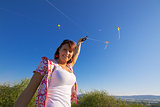 Smiling girl with kite