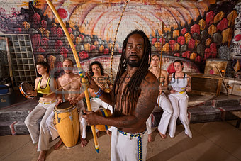 Capoeira Man with Dreadlocks and Instruments