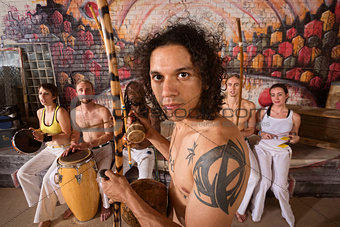 Capoeira Performers Playing Music