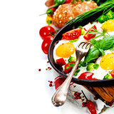 Fried eggs with fresh vegetables