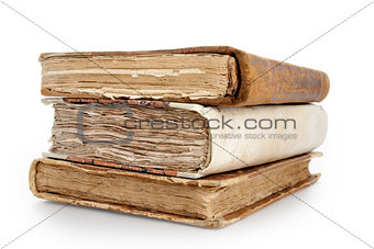 three old books on a pile