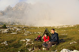 Young people camping in the mountains in fog