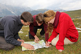 Searching the destination on a map in the mountains