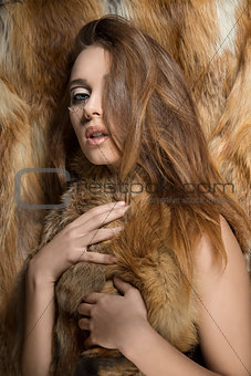 sexy girl with fur in glamour shoot