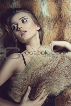 sensual glamour woman on fur background