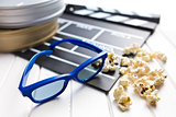3d glasses with clapperboard and popcorn