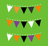 Colorful Halloween Bunting isolated on green background