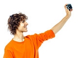 young man holding camera photographing portrait