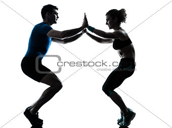 man woman exercising squats workout fitness silhouette