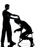 back massage therapy with chair silhouette