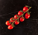 Vine tomatoes on marble table