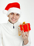man in a Santa hat with Christmas gift