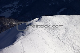 Top view on off piste slope in evening