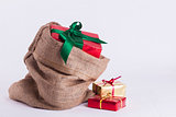 Wrapped Christmas present in Hessian sack