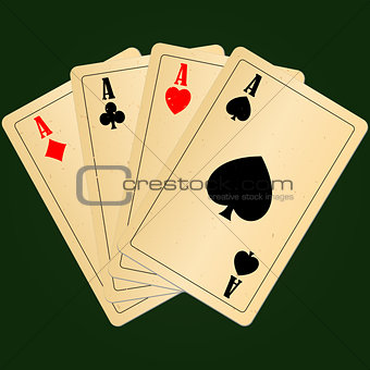 Four aces on green background